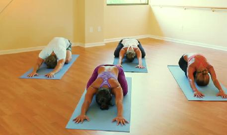 people at a yoga class performing yoga exercises